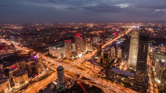 T/L WS HA PAN Aerial View of Beijing Dramatic Urban Skyline at Dawn, Night to Day Transition video