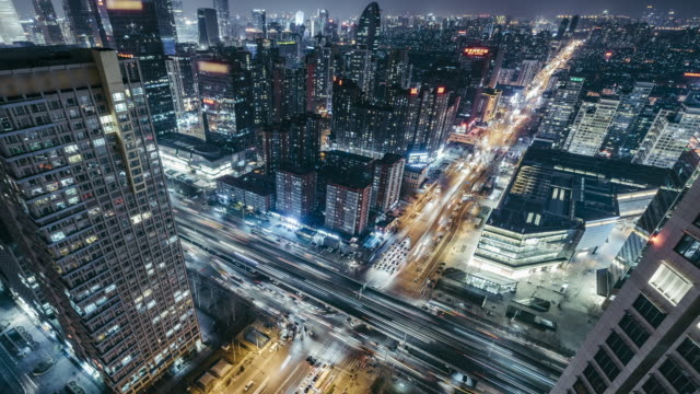 T/L WS HA PAN Aerial View of Beijing Road Intersection at Night