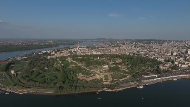 aerial view of belgrade city capital of serbia with buildings bridges cars and sava and danube rivers view from above - белград стоковые видео и кадры b-roll