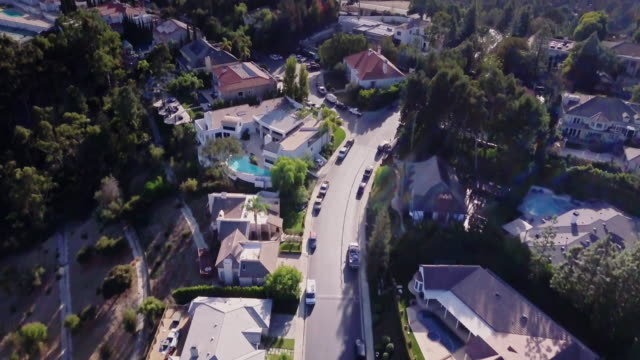 Aerial View of Beverly Hills Mansions Drone flight over the mansions and estates on Gene Autry Ridge in Beverly Hills, California. mansion stock videos & royalty-free footage