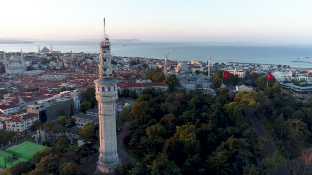 aerial view of beyazit tower and istanbul's historical peninsula in the background /4k - grand bazaar video stock e b–roll