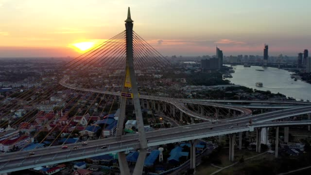 aerial view of bhumibol bridge industrial ring bridge crossing the chao phraya river twice at night