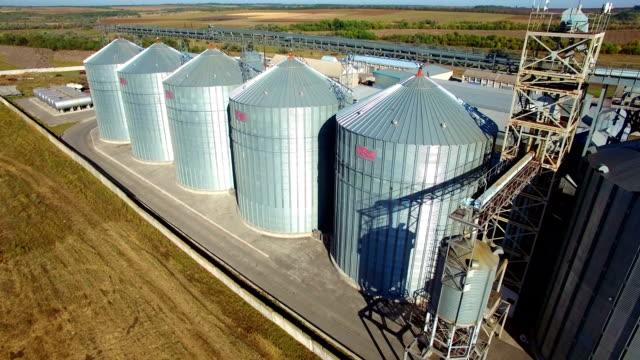 aerial view of big grain elevators - aerial agriculture stock videos & royalty-free footage