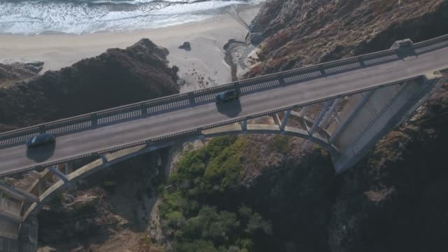 4k aerial view of bixby creek bridge in big sur california usa - california video stock e b–roll