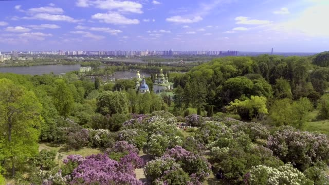 Aerial view of blooming lilacs and Church of the Botanical Garden, Kiev, Ukraine video