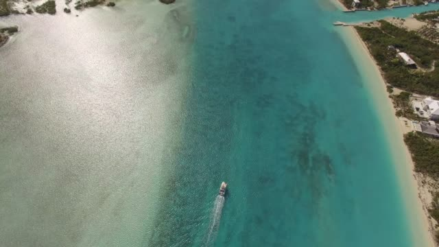 aerial view of boat in grace bay, providenciales, turks and caicos - wyspa land feature filmów i materiałów b-roll