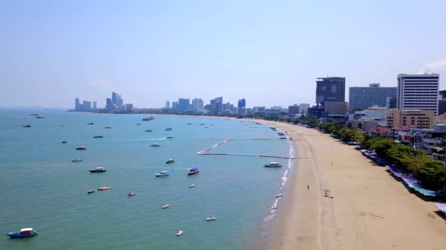 Aerial view of boats in Pattaya sea, beach, and urban city with blue sky for travel background. Chonburi, Thailand. Aerial view of boats in Pattaya sea, beach, and urban city with blue sky for travel background. Chonburi, Thailand. pattaya stock videos & royalty-free footage