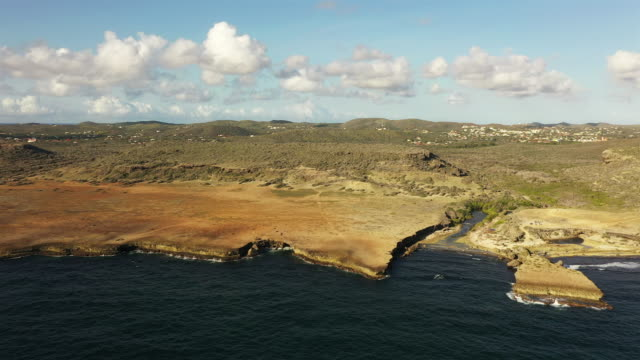 Aerial view of Boka Patrick - Curaçao - Caribbean Sea with turquoise water, cliff, beach and beautiful coral reef video