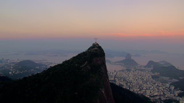 Aerial view of Botafogo Bay and Sugarloaf Mountain, Rio de Janeiro, Brazil Aerial view of Botafogo Bay and Sugarloaf Mountain at sunset, Rio de Janeiro, Brazil. jesus christ stock videos & royalty-free footage