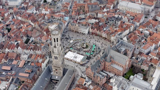 aerial view of bruges iconic market square with belfry of bruges tower - bruges video stock e b–roll