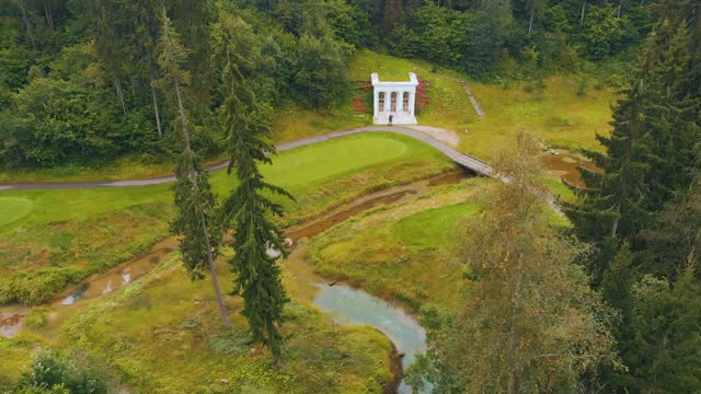 Aerial view of buildings golf club of among forest, river, beautiful panorama