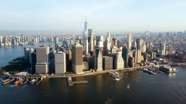 aerial view of busy new york city in america, manhattan district on the shore of east river. drone flies to city centre - helikopter filmów i materiałów b-roll