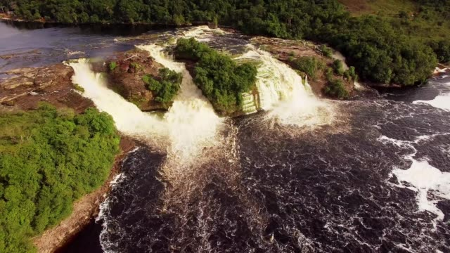 Aerial view of Canaima National Park Lagoon waterfalls. Canaima is a world known place for the beauty of nature and countless waterfalls. Canaima is visited for tourist all around the world. Aerial view of Canaima National Park Lagoon waterfalls. Canaima is a world known place for the beauty of nature and countless waterfalls. Canaima is visited for tourist all around the world. back to back stock videos & royalty-free footage