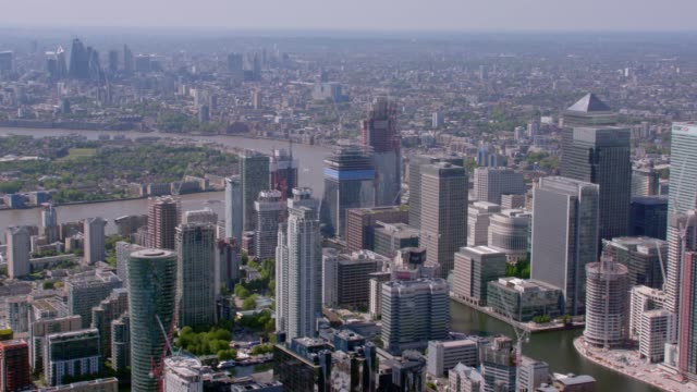 Aerial View of Canary Wharf and Central London, UK. 4K An aerial view of Canary Wharf and the River Thames with Central London and The Shard in the background. Filmed from a helicopter in full 4K in lovely sunshine. 29.97fps european culture stock videos & royalty-free footage