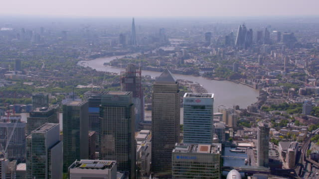 aerial view of canary wharf, london, uk. 4k - london architecture stock videos & royalty-free footage