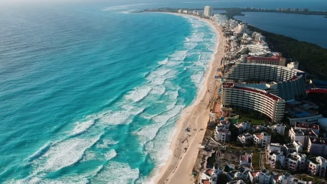 Aerial view of Cancun caribbean sea, the drone is flying upward