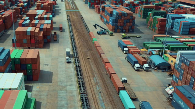 aerial view of cargo containers in railroad yard,time lapse - tor kolejowy filmów i materiałów b-roll