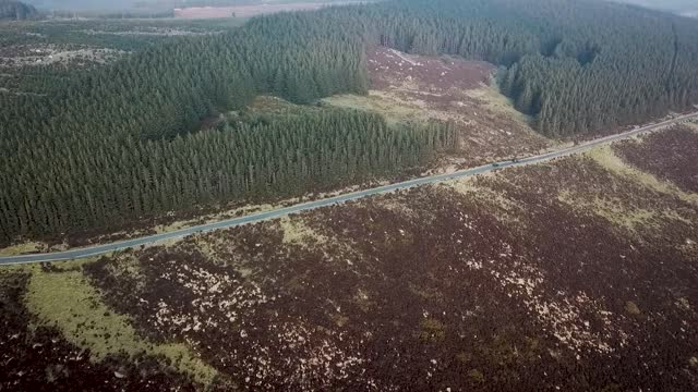 Aerial View of Cars Driving Along Road in Wicklow Mountains