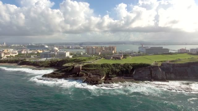Aerial view of Castillo San Felipe del Morro in Old San Juan, Puerto Rico Daytime aerial orbital shot around El Morro fortress in Old San Juan, Puerto Rico puerto rico stock videos & royalty-free footage
