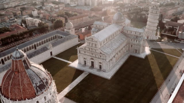 aerial view of cathedral and leaning tower of pisa - pisa stok videoları ve detay görüntü çekimi