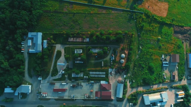Aerial view of cement factory, large industrial building in the countryside. 4K.