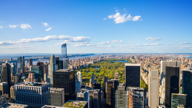 Aerial view of Central Park, Manhattan, New York City Time lapse of New York City skyline during the day, helicopter point of view of Central Park central park manhattan stock videos & royalty-free footage