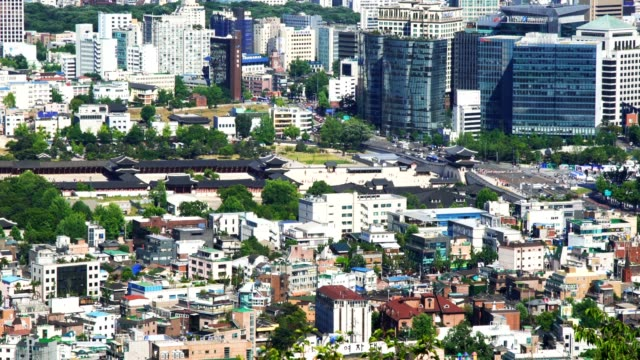 Aerial view of central Seoul cityscape Gyeongbokgung Palace entrance on the right in South Korea capital city gyeongbokgung stock videos & royalty-free footage
