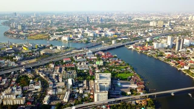 aerial view of chao phraya bangkok riverside downtown district - fiume chao phraya video stock e b–roll
