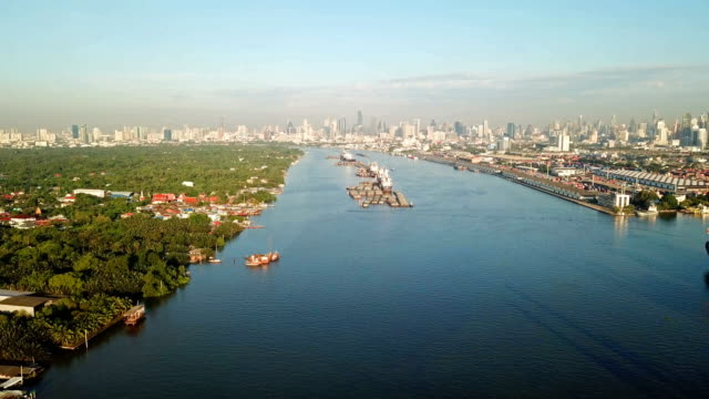 aerial view of chao phraya river, bangkok downtown. financial district and business centers in smart urban city in asia. skyscraper and high-rise buildings at noon. - fiume chao phraya video stock e b–roll