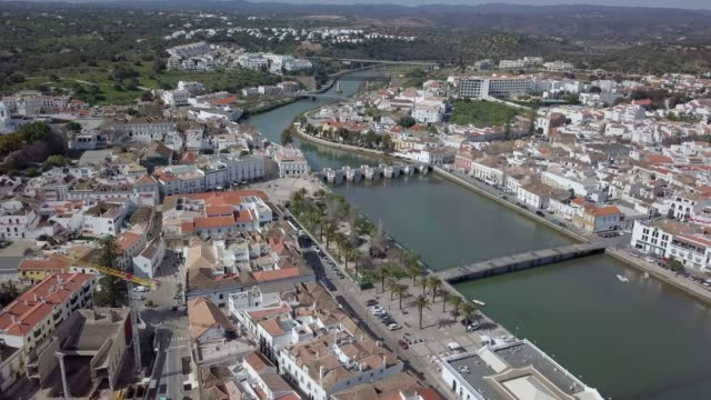 Aerial view of charming Tavira with roman bridge in sunny day, Portugal