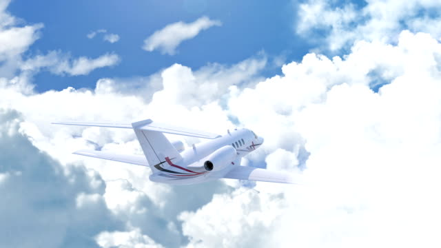 Aerial view of charter private jet flying above white clouds Aerial view of charter private jet flying above white clouds in a clear sunny day, camera following the plane, 3d render private airplane stock videos & royalty-free footage