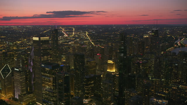 Aerial view of Chicago at dusk. Chicago, Illinois circa-2019.  Aerial view of Chicago at dusk.  Shot from helicopter with Cineflex gimbal and RED 8K camera. chicago stock videos & royalty-free footage