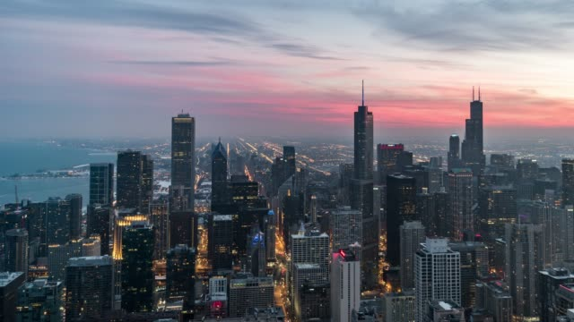 T/L PAN Aerial View of Chicago Skyline, from Sunset to Night High Angle view of Chicago Skyline chicago stock videos & royalty-free footage