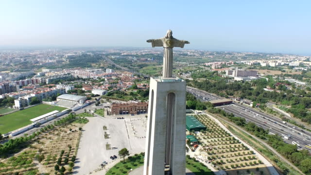 Aerial view of Christ the King sculpture Aerial view of Christ the King sculpture in Almada, Lisbon. cristo redentor stock videos & royalty-free footage