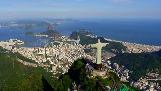Aerial View of Christ the Redeemer and Sugarloaf in Rio de Janeiro, Brazil Aerial view of Christ the Redeemer statue and Sugarloaf Mountain in Rio de Janeiro, Brazil. cristo redentor stock videos & royalty-free footage