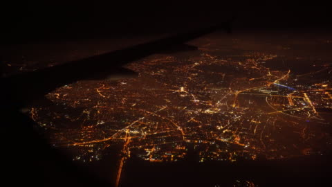 Aerial view of city at night when airplane flying on sky - Stock video Aerial view of city at night when airplane flying on sky - Stock video aircraft point of view stock videos & royalty-free footage