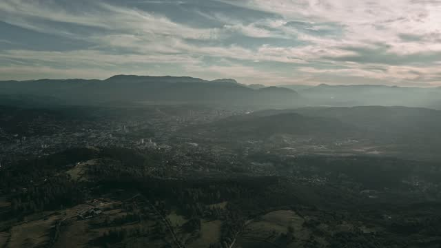 Aerial View of city Sarajevo from the countryside on a sunny day.