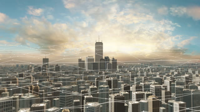 Aerial view of city skyline with futuristic network connections.