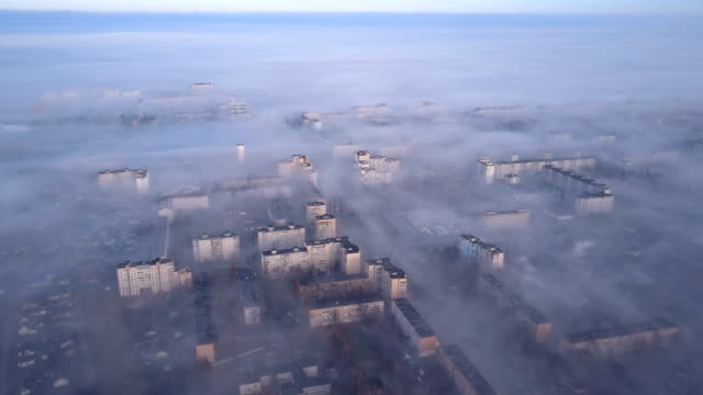 Aerial view of cityscape in smoke and fog. Aerial view of cityscape in smoke and fog. Beautiful view from bird's eye view to very dense morning fog over city. Smog or fog in the city. Problem of pollution of the environment by smoke and smog. beirut stock videos & royalty-free footage