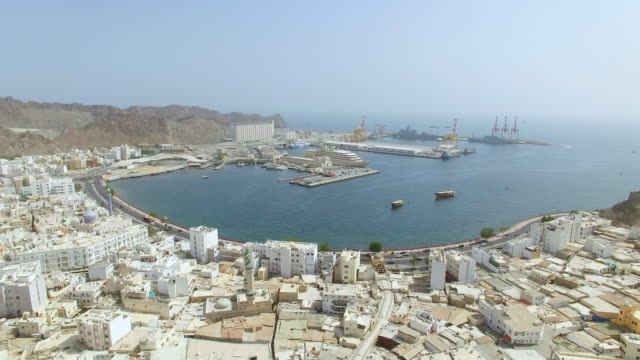 aerial view of cityscape of muscat, harbor and capital city of oman, sultanate on arabian peninsula, 4k uhd - oman filmów i materiałów b-roll