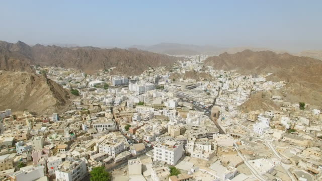 aerial view of cityscape of muscat, harbor and capital city of oman, sultanate on arabian peninsula, 4k uhd - oman video stock e b–roll