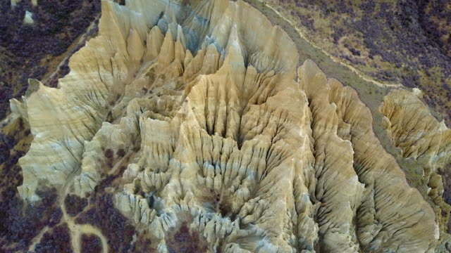 4K. Aerial view of clay cliffs near Omarama, natural rock formations in South Canterbury, South Island, New Zealand.