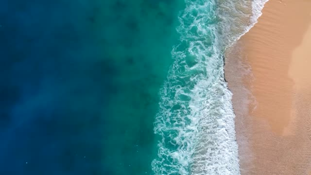 Aerial view of clear turquoise sea and waves