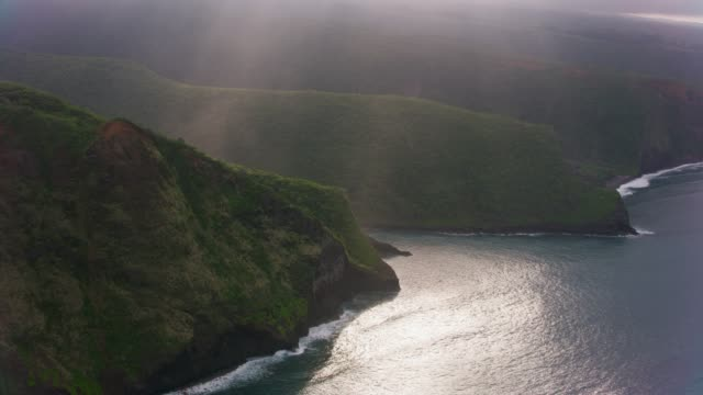 Aerial view of cliffs along Hawaii coastline. Big Island, Hawaii circa-2018.  Aerial view of cliffs along Hawaii coastline.  Shot with Cineflex and RED Epic-W Helium. big island hawaii islands stock videos & royalty-free footage