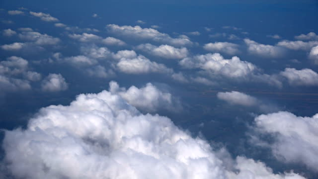 Aerial view of clouds, mountains from airplane, Vietnam video