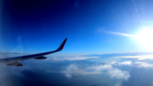 Aerial view of cloudy and blue sky when airplane flying
