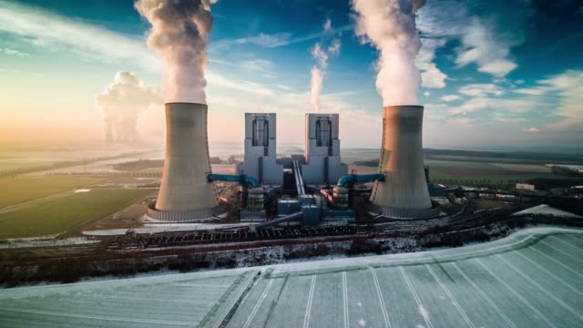 Aerial view of Coal-fired Power Plant Aerial shot of a coal burning power plant on a cold winter morning. Kraftwerk Neurath North Rhine-Westphalia, Germany, Europe coal stock videos & royalty-free footage