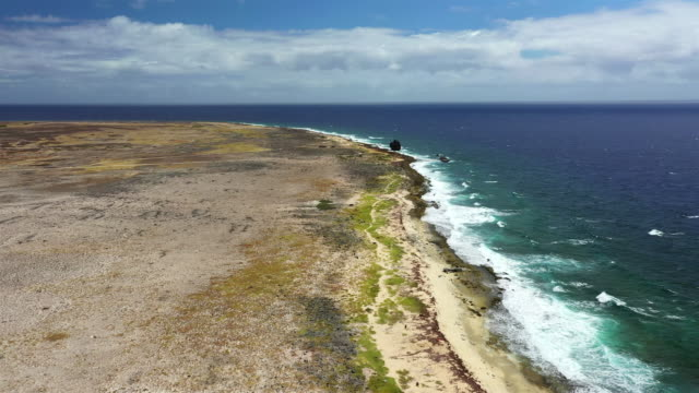 Aerial view of coast of Klein Curacao in the Caribbean Sea with turquoise water, cliff, beach and beautiful coral reef video