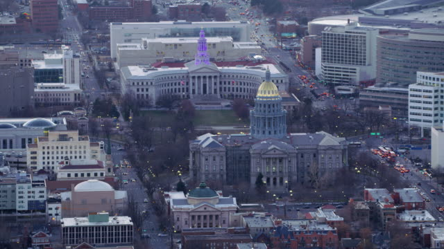 aerial view of colorado state capitol building and denver city and county building - capitello video stock e b–roll