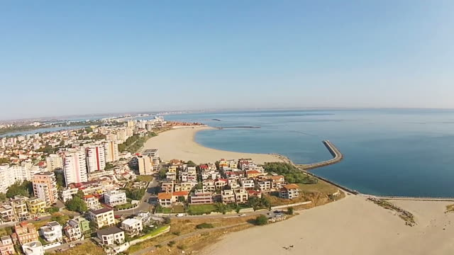 Aerial view of Constanta , major city on the Black Sea coast, Eastern Europe , with lakes in the background and Mamaia holiday resort, a top travel destination on the Romanian seaside , drone footage
